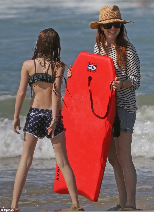 Bodyboard time: The duo were also seen at the beach as Liv enjoyed a water sports session