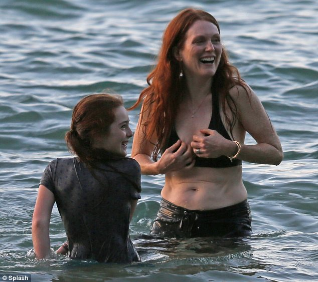 Giggling girls: Julianne and her daughter were also seen laughing together