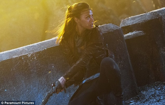 Action packed: Zoe Saldana leads the way in these official movie stills from the new upcoming Star Trek film