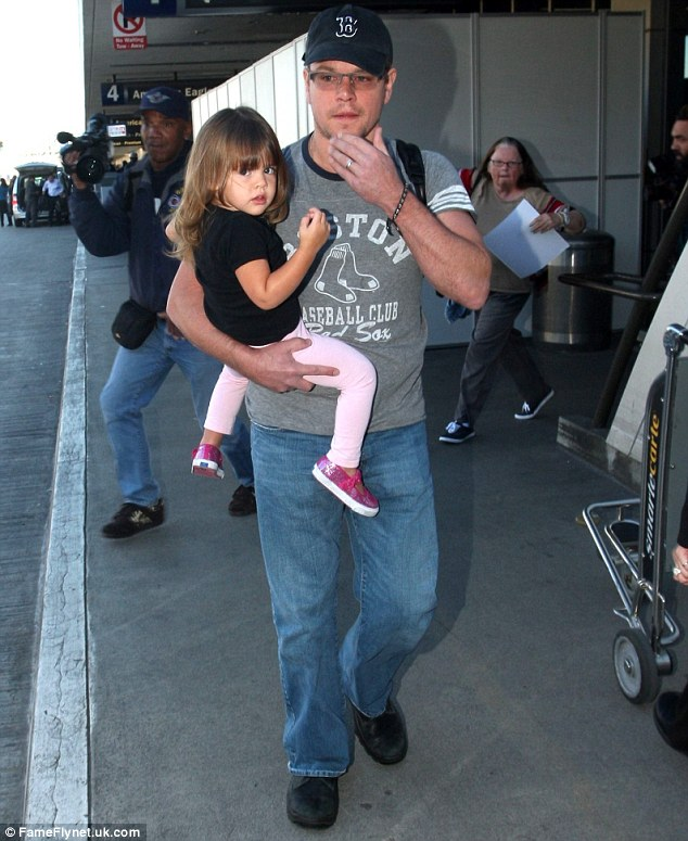 Dressed down dad: Matt looked casual in a pair of jeans, baseball T-shirt and cap