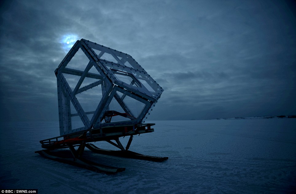 The pod was built of perspex and metal and withstood the fierce onslaught from the eight-foot predator
