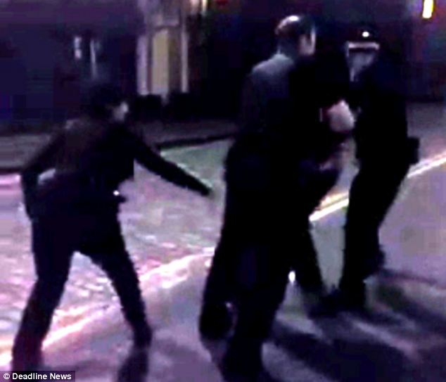 The video aprears to show three Lothian and Borders officers arresting a man in the street