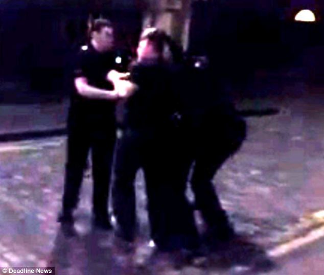 This video clip shows an officer marching towards the cameraman and smacking the mobile out of the way - the cameraman claimed he was arrested afterwards