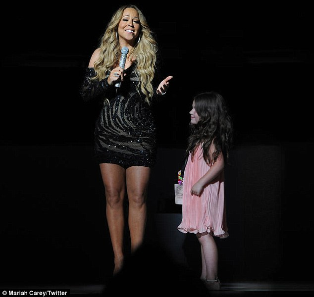 Little diva: Mariah Carey met her mini-me on stage in Sydney, Australia on Thursday as she wore a tight dress