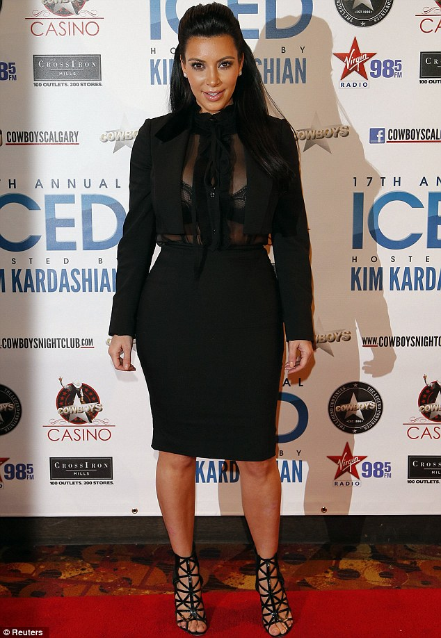 Not slowing down: Kim Kardashian was flaunting her pregnancy body in Calgary, Alberta on Friday