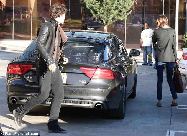 Orlando Bloom picks uip wife Miranda Kerre outside of an LA spa where the Victoria's Secret model spent the day