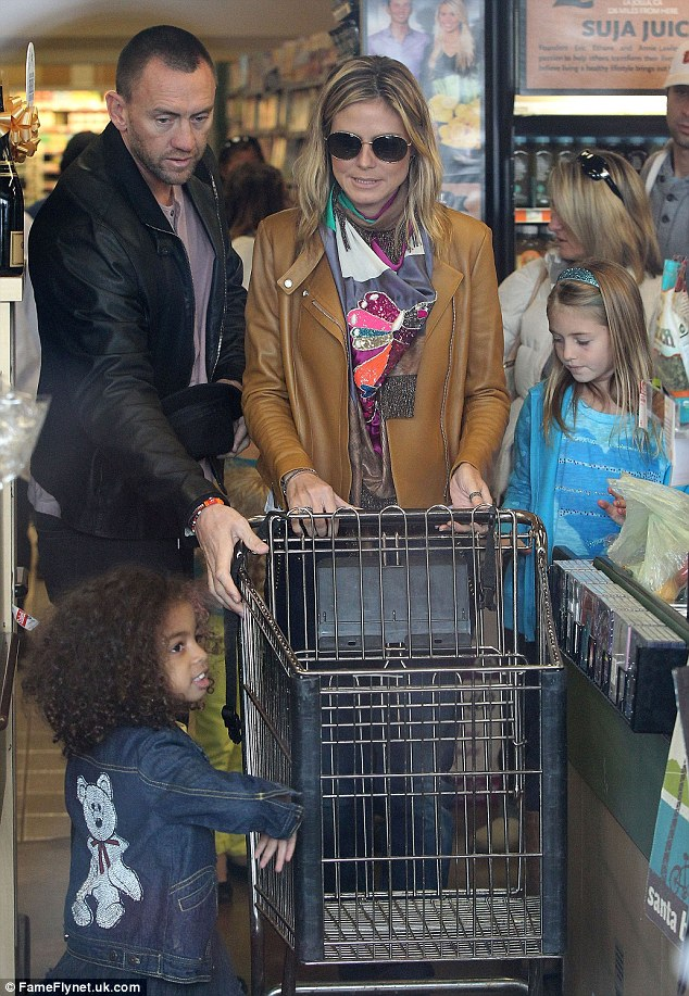 Grocery run: Heidi and Martin, with her daughters Leni and Lou in tow, visited Whole Foods on December 30 to stock up