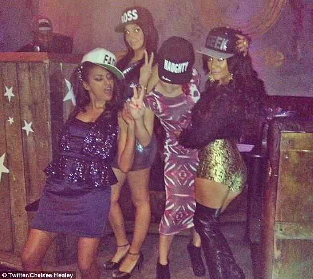 Cap-ital night: Tulisa, Chelsee and her friends wear baseball caps on their night out