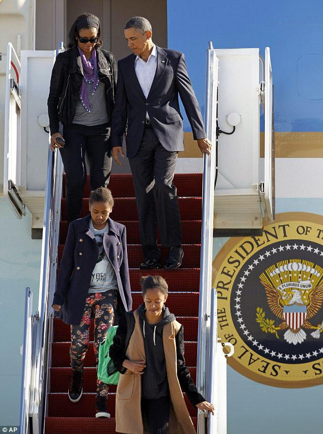 Their current home: First Lady Michelle and the first daughters Sasha (left) and Malia (right) were in Hawaii for the entirety of the girl's Christmas break, but the President had to go back to D.C. over New Year's