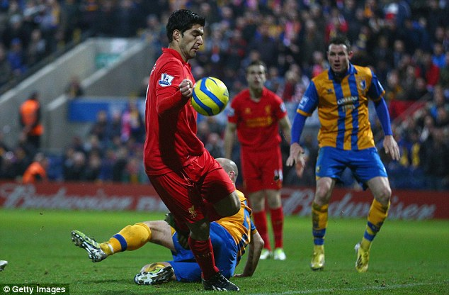 Instinct or intent? Luis Suarez handled the ball before he scored for Liverpool