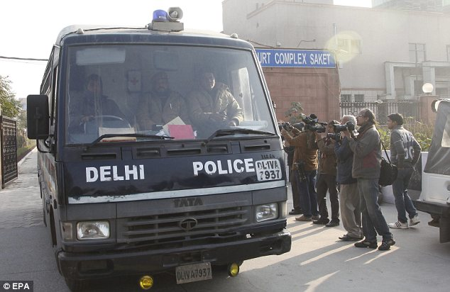 On trial: A police van carrying five of the six suspects in the case leaving court in Delhi on Monday