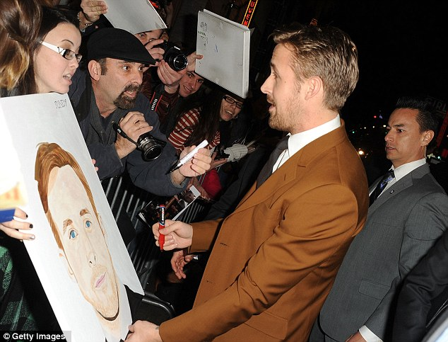 Heartthrob: Female fans clamoured to get an autograph from hunky Ryan