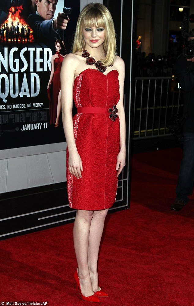 Ravishing in red: Emma Stone looked sensational in a scarlet strapless dress at the premiere of Gangster Squad at Grauman's Chinese Theatre in Hollywood on Monday night