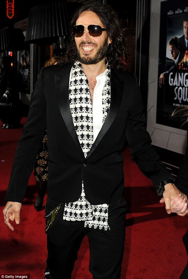 Rock & Roll: Russell Brand brought his usual rock and roll edge to the red-carpet, but spruced up his often raggedy look with a black tuxedo jacket, open-neck white shirt and skull printed silk scarf