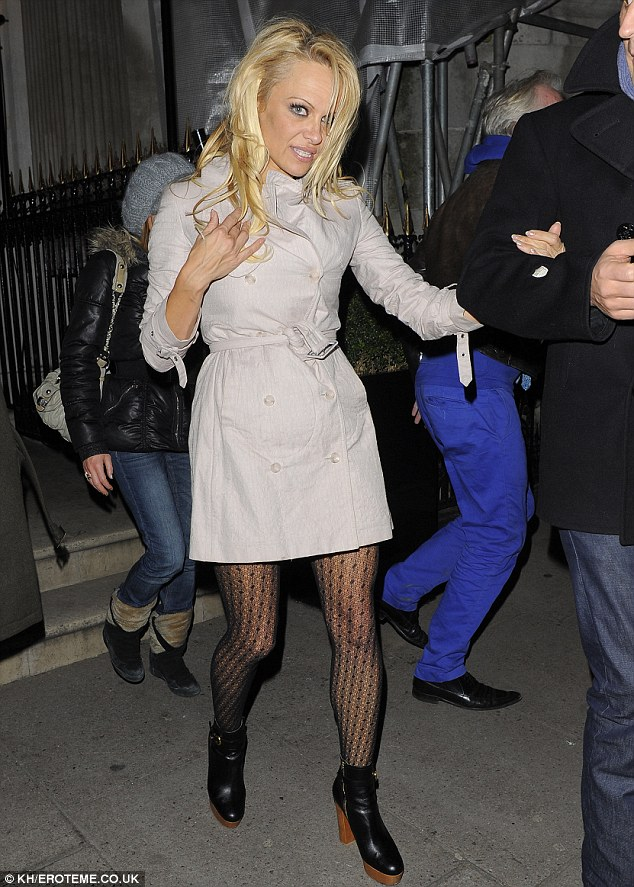 Looking better: She started the night off in better shape without her tights being ripped