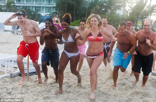 Ready, set, RUN! Alexandra Burke was seen racing her friends down to the sea as she enjoyed the final day of her holiday in Miami