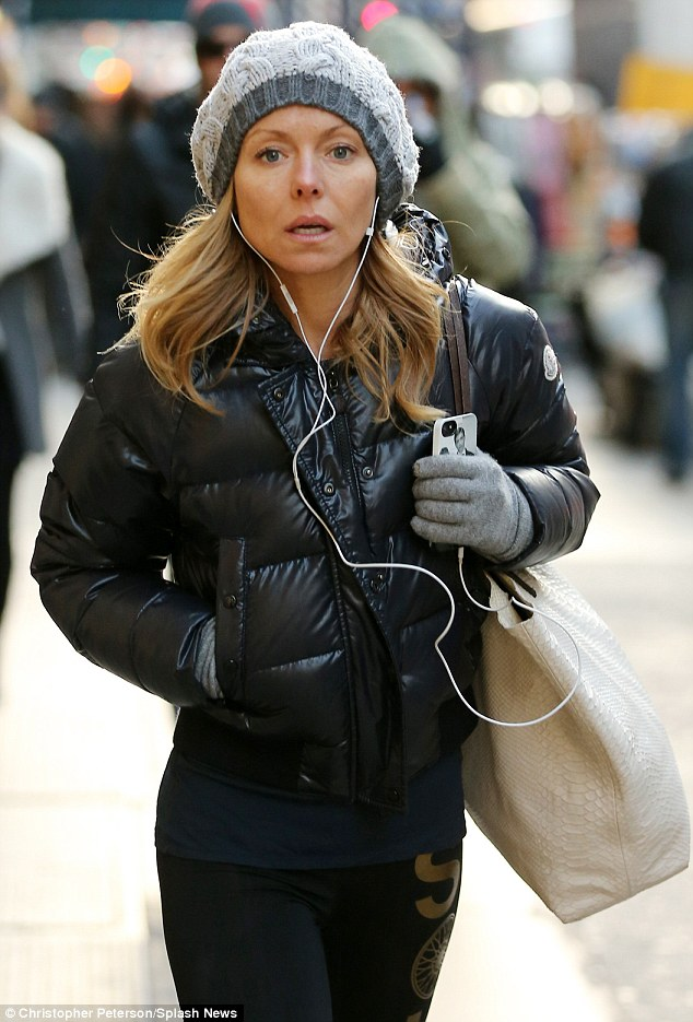 Brisk walk: Make-up free Kelly Ripa got two workouts in on Tuesday as she briskly walked to the gym in New York City