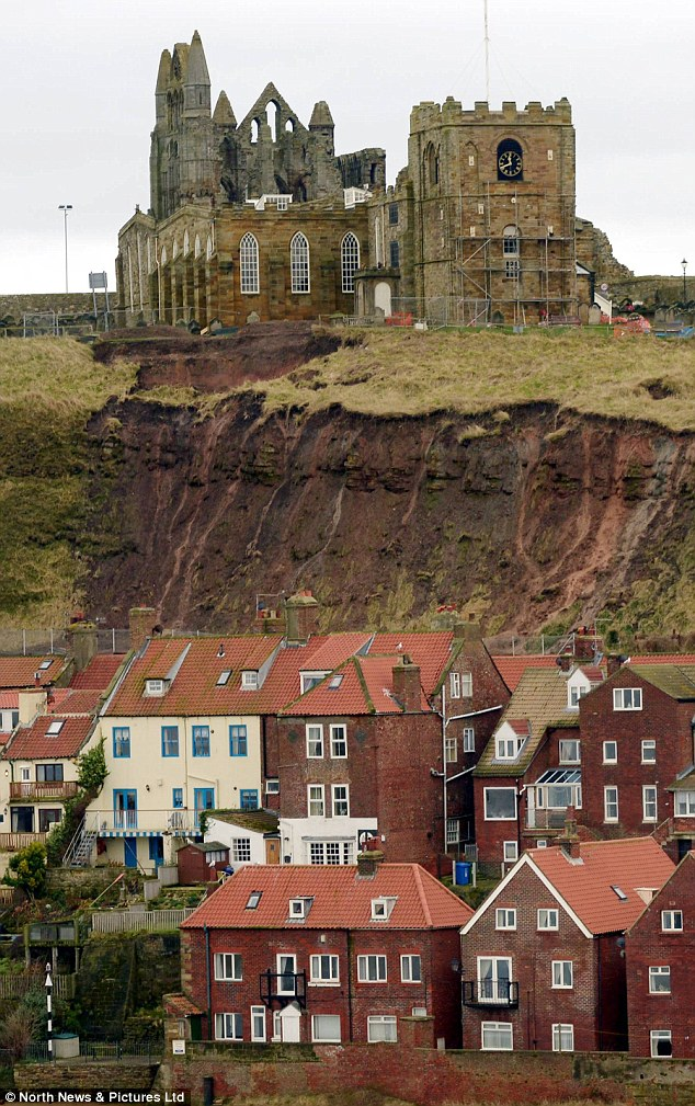 Debris: More cracks have appeared in the cliff face this week following heavy rainfall