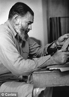 Though pictured sitting with his typrewriter in 1944, Ernest Hemingway, liked to write standing