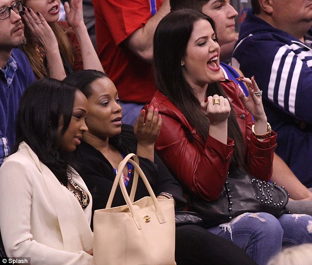 Supportive spouse: Khloe could be seen cheering her man on from the stands as his team took on the Dallas Mavericks