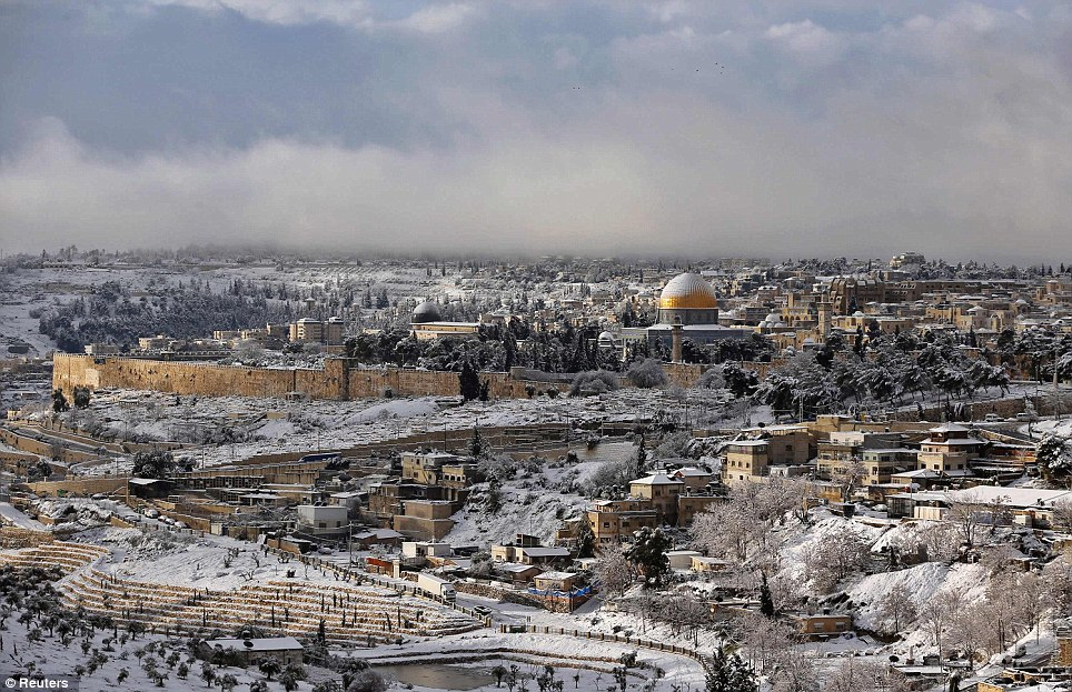 Snow covers the Dome of the Rock on the compound know to Muslims as al-Haram al-Sharif and to Jews as Temple Mount after the worst snowstorm to hit Jerusalem for 20 years
