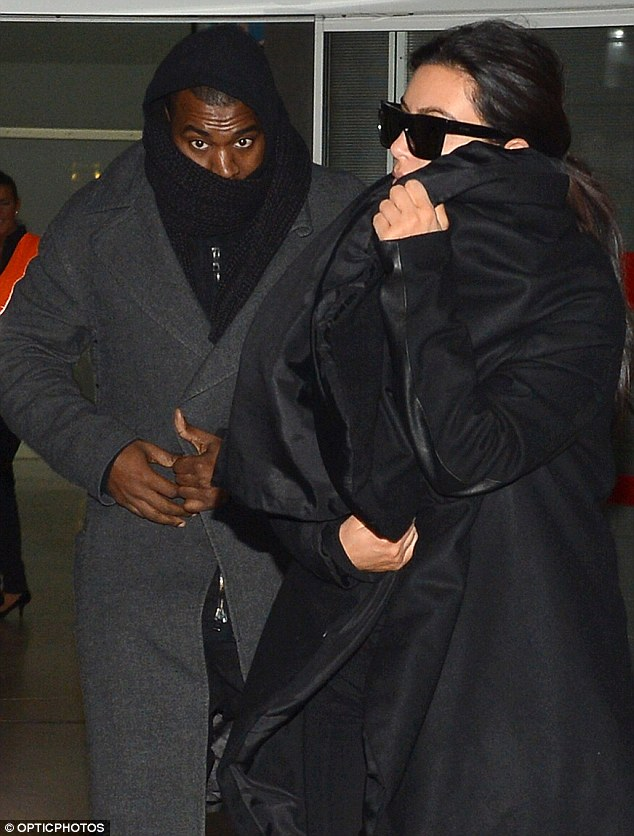Chilly: Meanwhile, Kanye didn't seem like he was enjoying the chilly weather at all, wearing not one, but two jackets through the airport and wrapping a scarf around his head and face