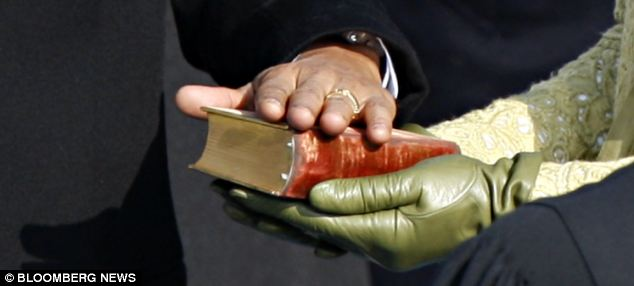 President Obama, top hand, is sworn in as wife Michelle holds up the same Bible used by former President Abraham Lincoln during Barack's inauguration ceremony in 2009