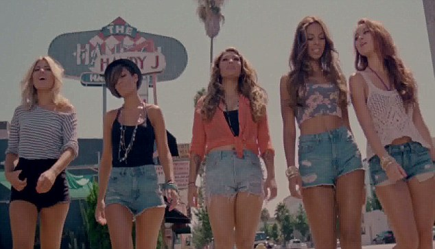 Tiny shorts: The Saturdays show off their enviable legs in their trademark look