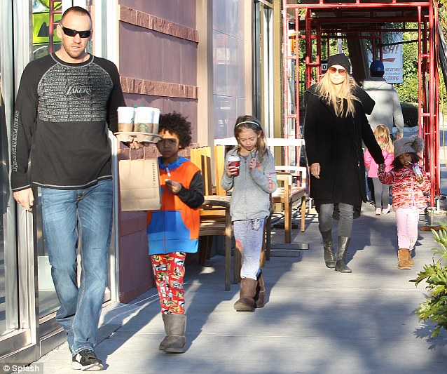 Family outing: Heidi Klum was spotted with Martin Kristen and her kids at Starbucks in Brentwood, California