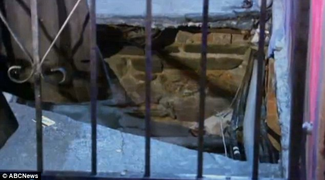 Williams fell seven foot into the basement of the Atomic Wings restaurant. Her subway card can be seen sitting beside the hole
