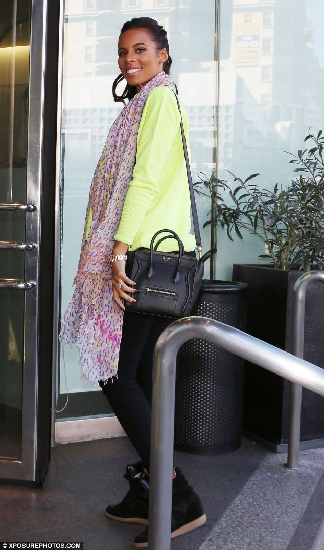 Mum to be: Rochelle Wiseman keeps her bump hidden behind a scarf as she attends a business meeting in LA with her bandmates
