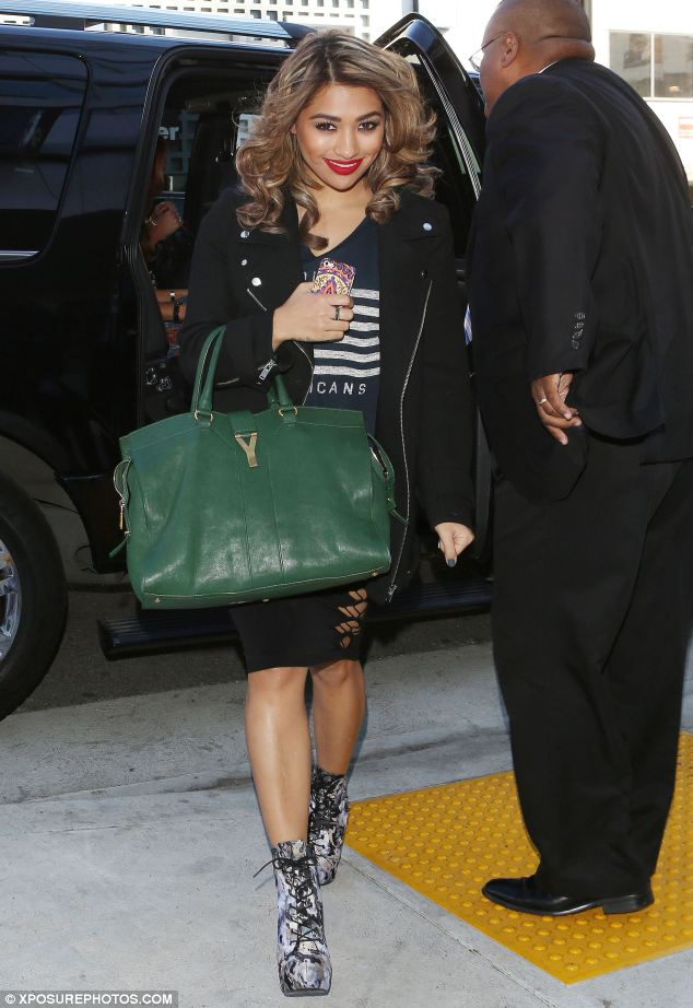 Cutie pie: Vanessa White smiles sweetly for the cameras as she is snapped arriving at a business meeting in LA
