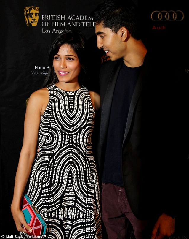 Happy couple: Slumdog millionaire stars Frieda Pinto and Dev Patel looked loved up as they posed on the red carpet