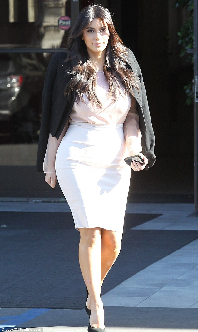 A mysterious glow: Kim Kardashian visited her family in Calabasas, Calif. this morning