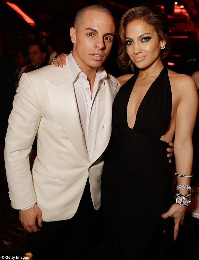 Stylish pair: Casper complemented Jennifer's outfit in his cream tuxedo