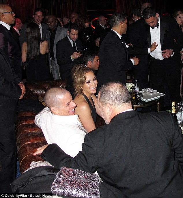 Enjoying yourselves? The couple looked relaxed as they partied the night away together in the same room as Diddy