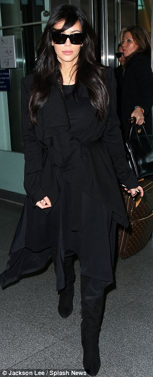 We're here: Kourtney was seen carrying Penelope through JFK airport after she and Kim arrived in New York