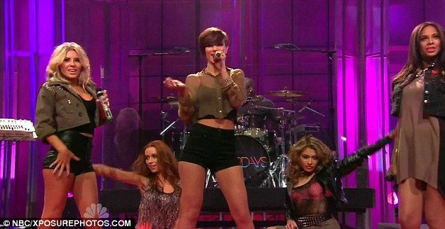 Super short: All of the band made sure their legs were out for their performance