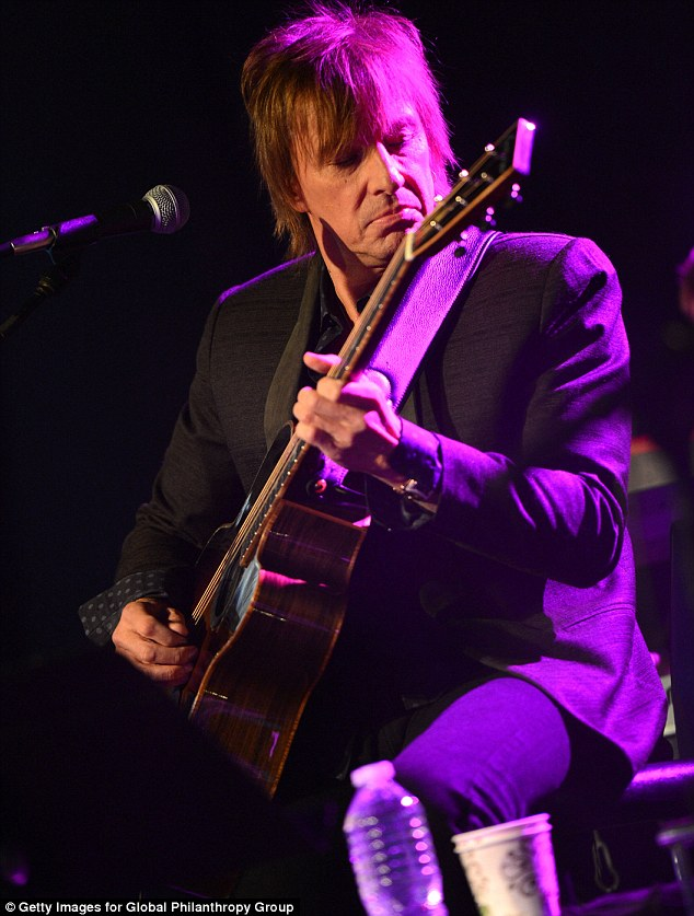 Getting into it: Richie seemed to be in another world as he strummed his guitar