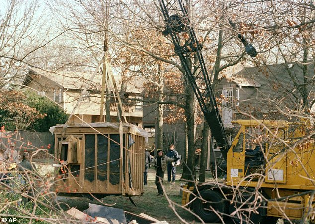 Dungeon: A crane raises a 6 foot by 9 foot bunker out of the earth at the property of John Esposito in this January 18, 1993 file photo