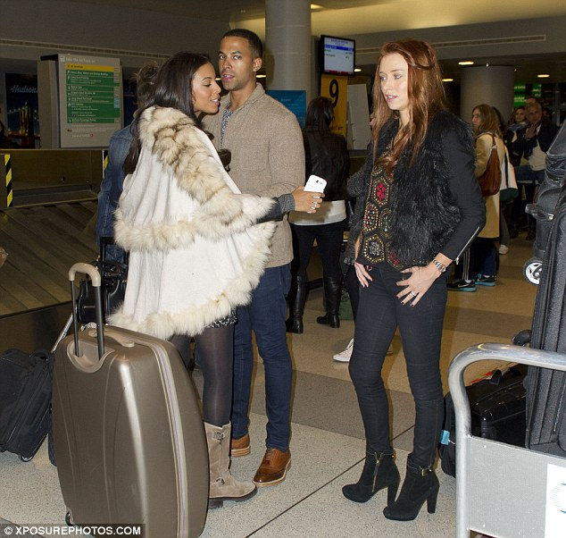 Affectionate hug: Rochelle and Marvin cuddle up as they chat to bandmate Una Healy