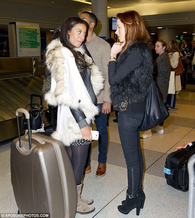 Hanging around: The girls chat while Marvin patiently waits for the luggage