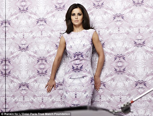 Still standing out! Cheryl Cole went for camouflage chic in a new campaign for L'Oreal Paris' True Match foundation, but still managed not to blend in with the background