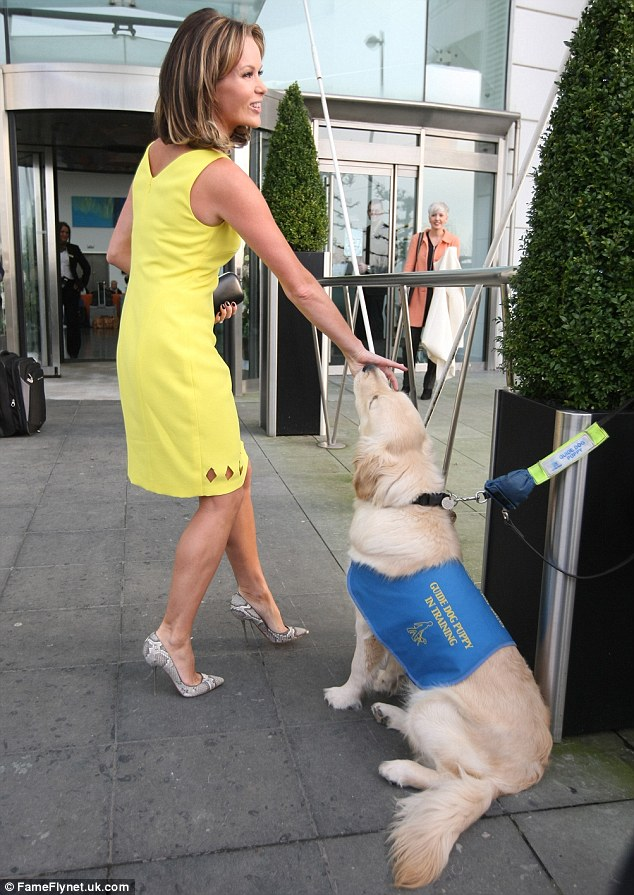 Furry friend: Amanda seemed equally besotted with the adorable animal