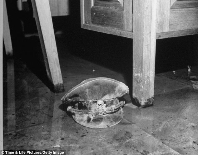 Left over: A mould-covered Nazi SS officers cap with a Death Skull insignia on the bunker's floor