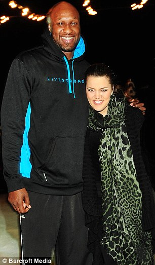 Fed up: Khloe Kardashian, pictured with husband Lamar Odom declared herself 'fed up' with false stories on Wednesday