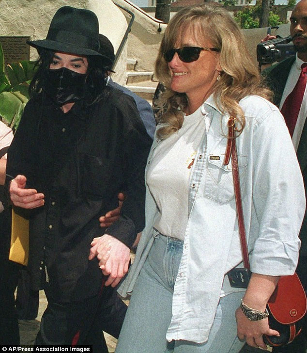 Hand in hand: Jackson, who died in 2009, fathered Prince Michael and daughter Paris with ex-wife Debbie Rowe, pictured here in 2006