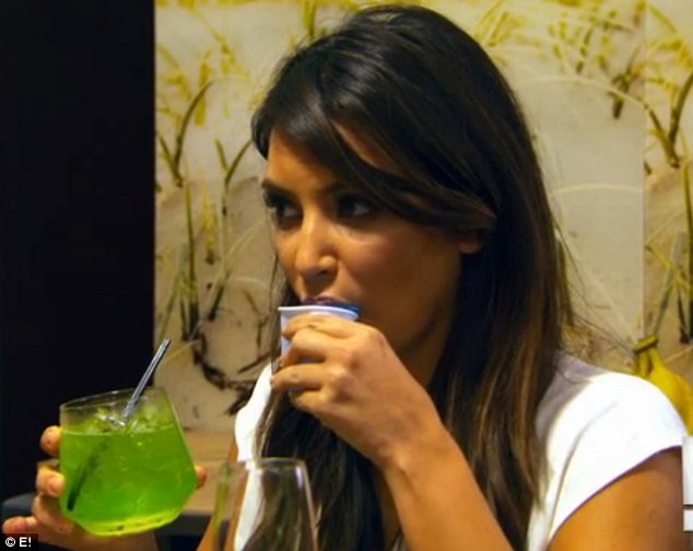 Party time: Kim and Khloe Kardashian are seen getting stuck into some drinks in a new preview clip for Kourtney and Kim Take Miami