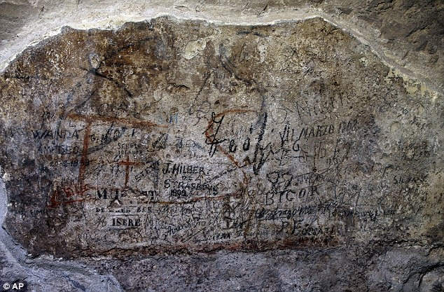 The ancient graffiti, seen here in red in the background, was another discovery of the restoration