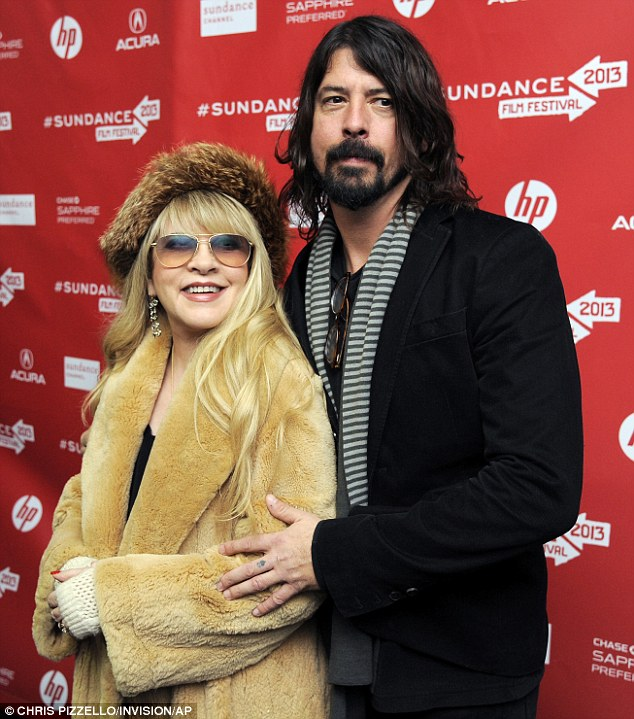 Rocking out on film: Former Nirvana drummer Dave Grohl, posing with rock goddess Stevie Nicks, was at Sundance for his directorial debut, a documentary called Sound City